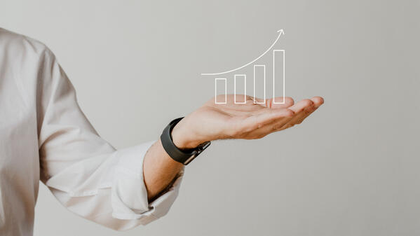 digital-increasing-bar-graph-with-businessman-hand-overlay-1
